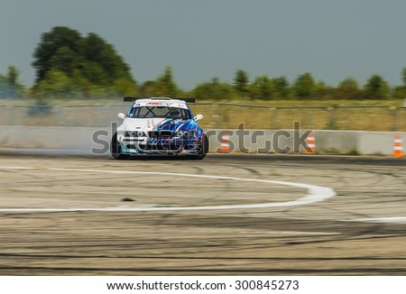 Vinnytsia,Ukraine-July 24, 2015: Rider Igor Zapisniy  on the car brand BMW overcomes the track in the  Drift championship of Ukraine  on July 24,2015 in Vinnytsia, Ukraine.