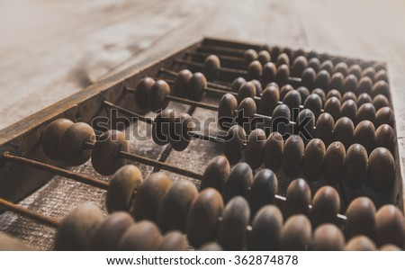 Vintage abacus on wooden background - stock photo