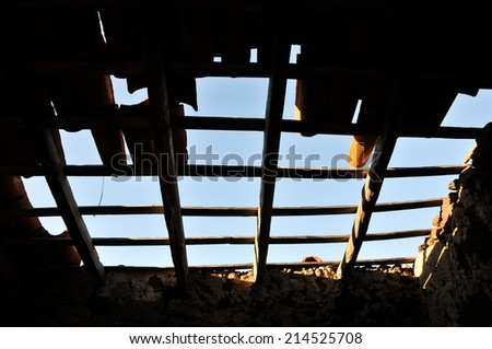 Vintage Abandoned Damaged house Roof With Missing Slates - stock photo