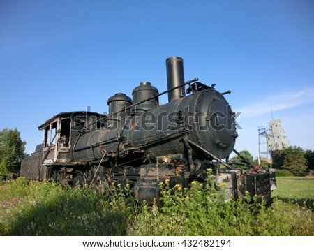 Vintage abandoned rusty old steam engine locomotive