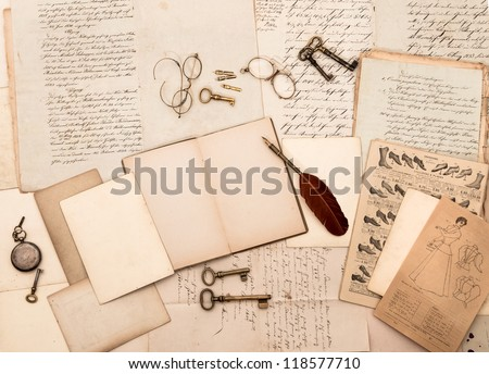 vintage accessories and open book with old letters. nostalgic fashion background - stock photo