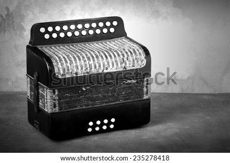 Vintage accordion musical instrument on grunge still life style black and white version