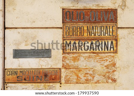 vintage advertising sign for olive oil, butter and margarine in the streets of rome, italy
