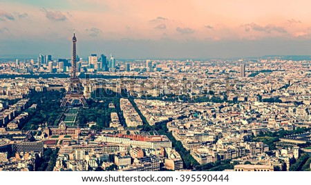 Vintage aerial view, from Montparnasse tower, with Eiffel tower and La Defense district in Paris, France. - stock photo