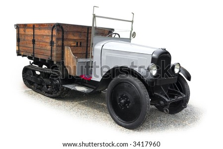 Vintage agricultural lorry with half track, on white background