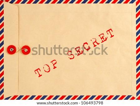 vintage airmail envelope. grungy background. text top secret - stock photo