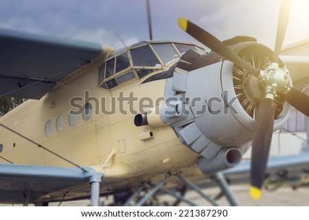 Vintage airplane, closeup. Retro colors, flare, tilt shift - stock photo
