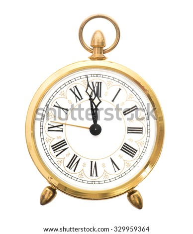 Vintage alarm clock isolated on white background. Five to twelve
