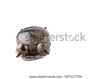 Vintage alarm clock isolated on white in selective focus - stock photo