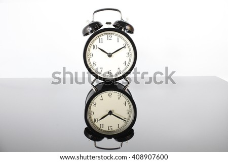 vintage alarm clock on white background