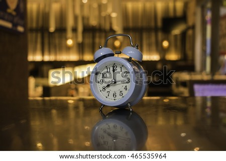 Vintage alarm clock with blurred background