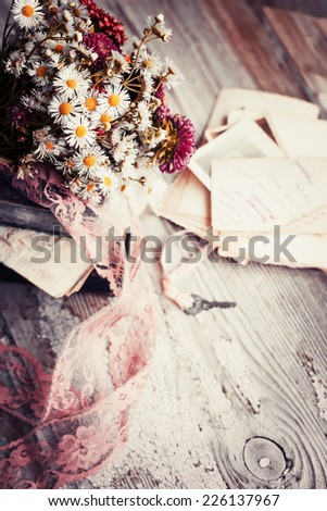 Vintage Albums with Photos of Memories,flowers,lettres and key/ toned image nostalgic vintage background