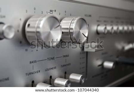 Vintage amplifier close up, old audio system - stock photo
