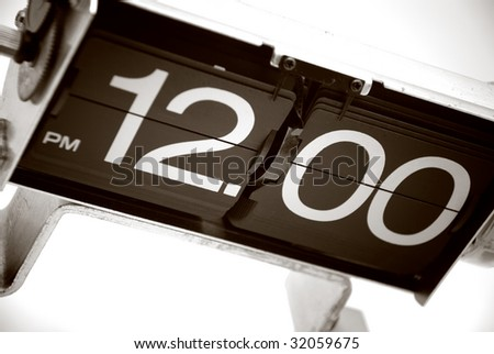 Vintage Analog Clock displays 12PM or lunchtime - stock photo