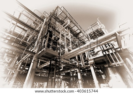vintage, analogue oil and gas refinery with torn edges, sepia toning - stock photo