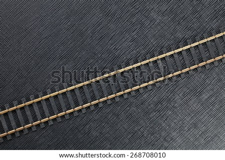 Vintage and classic miniature plastic model railway track represent the model railway and model making related idea concept.   - stock photo