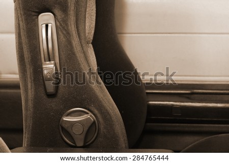 Vintage and classic style of black color leather car seat on sepia tone represent the texture surface background and car part concept related idea.