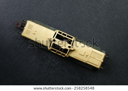Vintage and classic toy train model of diesel locomotive put on the black color leather background represent the train transportation related. - stock photo