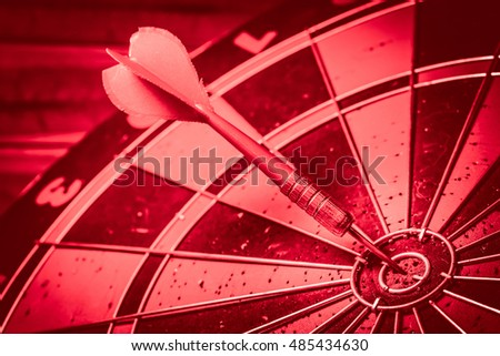 Vintage and Red Tone: Bullseye is a target of business. Dart is an opportunity and Dartboard is the target and goal. So both of that represent a challenge. - Target marketing or target arrow concept.