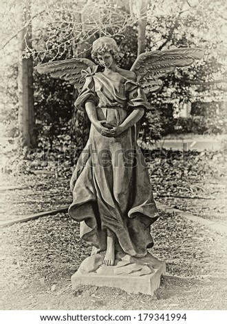 Vintage Angel Garden Statue - stock photo