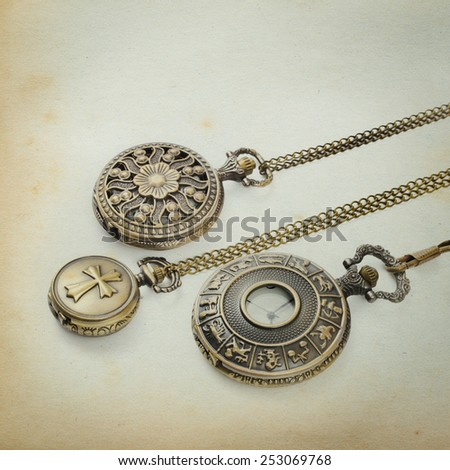Vintage Antique pocket watch on grunge paper background - stock photo