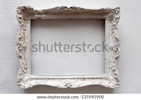 Vintage antique white frame on the white wall