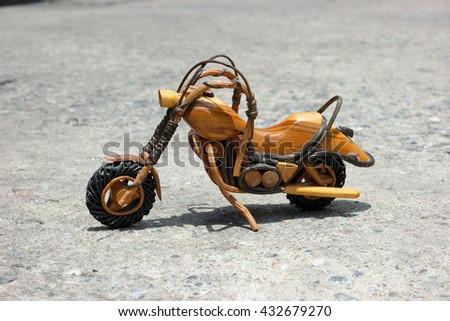 vintage antique wooden chopper or motorbike or motorcycle place on rough ground and ready dream to travel or adventure to anywhere on the earth - stock photo