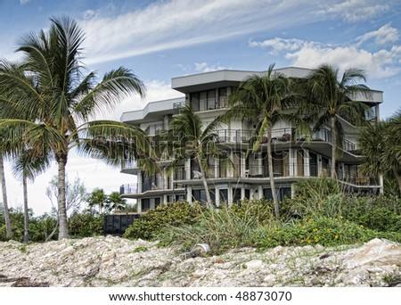 Vintage apartment building on a Key West Beach in the morning. - stock photo
