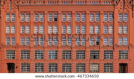 Vintage architecture red brick classical facade.Style building industrial Russian Gothic