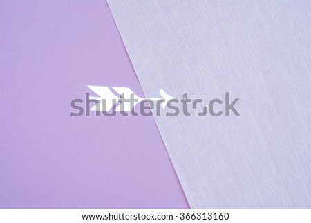 vintage arrow printed on antique violet paper texture - stock photo