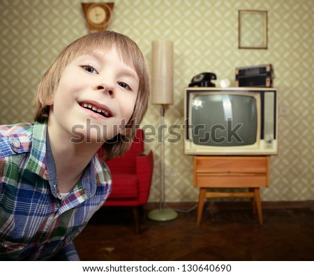 vintage art portrait of little boy looking out at camera in room with interior from 70s, retro stylization, toned