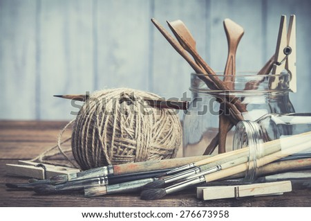 Vintage artists tools on rustic wooden background.  - stock photo