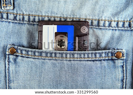Vintage Audio Tape Cassette in the Jeans Pocket closeup - stock photo
