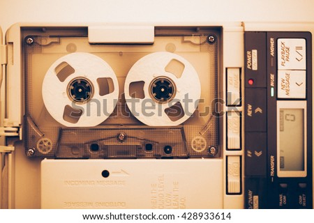 vintage audio tape compact cassette, sepia tone with artistic film noise - stock photo