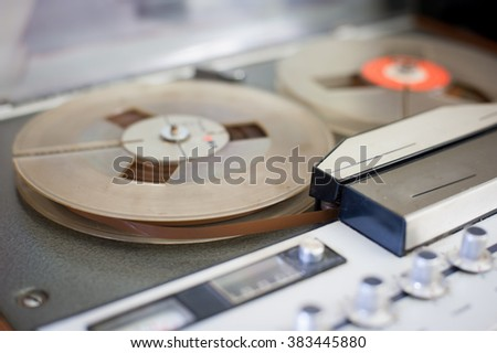 Vintage audio tape music recorder detail on magnetic tape - stock photo
