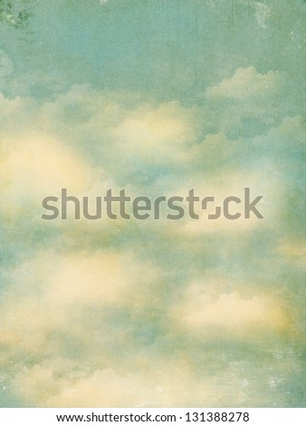 Vintage Background - Grungy textured sky postcard with fluffy white clouds - stock photo