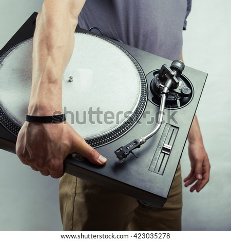 Vintage background. Man with turntable - stock photo