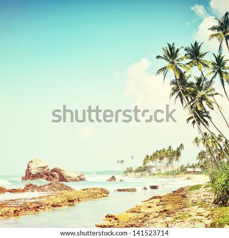 Vintage background. Retro tropical beach - stock photo