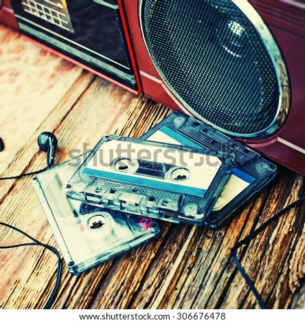 Vintage background with Cassette tapes over wooden table. - stock photo