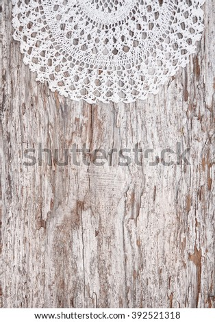 Vintage background with lace on the old rude wood - stock photo