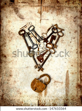 vintage background with locks and lots of  keys on wooden table with grunge texture/Heart from keys
