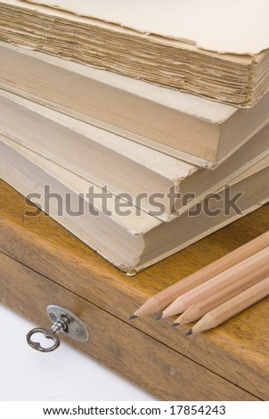 Vintage background with old books and wood box - stock photo