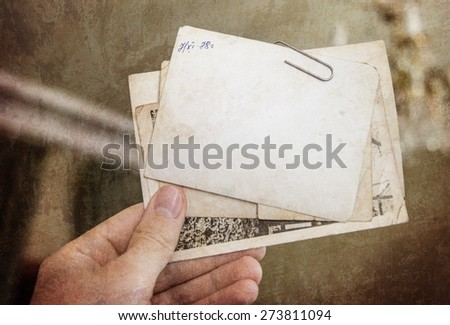Vintage background with old paper and letters keep in hand - stock photo
