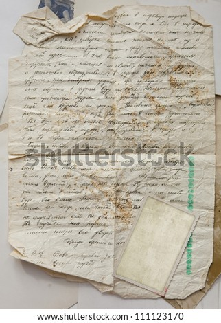Vintage background with old paper, letters and white photos frame - stock photo