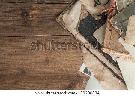 vintage background with old paper on a wooden table - stock photo