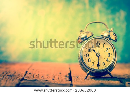 Vintage background with retro alarm clock on table.10.30 am good time of coffee for healthy - stock photo