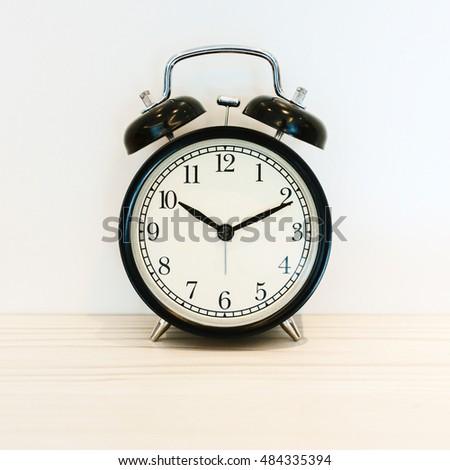 Vintage background with retro alarm clock on table, Black and white