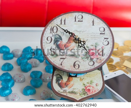 Vintage background with retro clock on table. selective focus. - stock photo