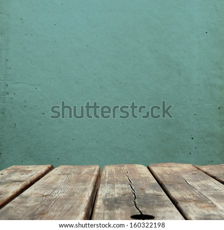 Vintage background with wooden bridge and grunge blue wall - stock photo