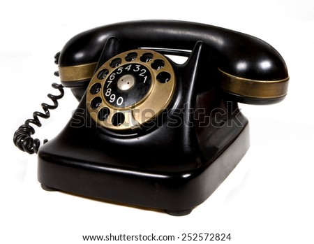 vintage bakelite telephone with brass detail - stock photo